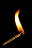 Καίγοντας αντιστοιχία στο Μαύρο Στοκ φωτογραφία με δικαίωμα ελεύθερης χρήσης