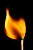 Καίγοντας αντιστοιχία στο Μαύρο Στοκ Φωτογραφίες