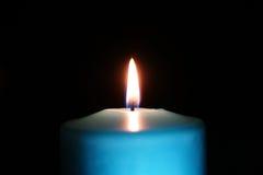 καίγοντας κερί που απομονώνεται μαύρο Στοκ Φωτογραφία