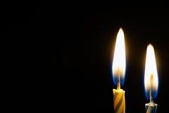 καίγοντας κερί που απομονώνεται μαύρο Στοκ Φωτογραφίες