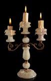 Καίγοντας κερί στο παλαιό ασημένιο κηροπήγιο που απομονώνεται Στοκ Εικόνες