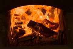 Καίγοντας πυρκαγιά στην εστία Στοκ Εικόνα