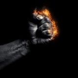 Καίγοντας σφιγγμένη το s πυγμή ατόμων ` Στοκ Φωτογραφίες