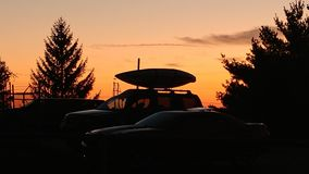 Καγιάκ στο ηλιοβασίλεμα στοκ φωτογραφία
