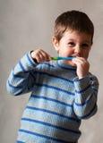 καθαρίζοντας δόντι Στοκ Φωτογραφίες
