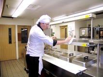 καθαρίζοντας κουζίνα Στοκ Εικόνες