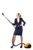 Καθαρισμός γυναικών με την ηλεκτρική σκούπα Στοκ φωτογραφία με δικαίωμα ελεύθερης χρήσης