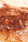 Καθαριστές που καθαρίζουν το τηγάνισμα παν Γ Στοκ Εικόνες