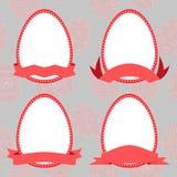 Καθορισμένα αυγά Πάσχας με την κορδέλλα Στοκ Εικόνα