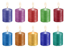 Καθορισμένα πολύχρωμα εορταστικά καίγοντας κεριά που απομονώνονται στο άσπρο β Στοκ εικόνες με δικαίωμα ελεύθερης χρήσης