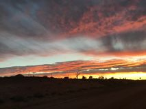 Καθορισμένα σύννεφα ήλιων Coober pedy Στοκ Φωτογραφίες
