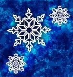 Καθορισμένα snowflakes Χριστουγέννων στο σκούρο μπλε υπόβαθρο grunge Στοκ Εικόνες