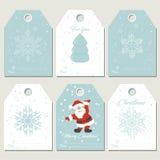 Καθορισμένες ετικέττες δώρων Χριστουγέννων με snowflakes στο αναδρομικό ύφος Στοκ εικόνα με δικαίωμα ελεύθερης χρήσης