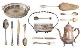 Καθορισμένες παλαιές ασημικές Δίσκος, κύπελλο ζάχαρης, κουτάλια, δίκρανα, κατσαρόλα, spatula για το κέικ, μαχαίρι η ανασκόπηση απ στοκ φωτογραφία με δικαίωμα ελεύθερης χρήσης