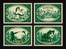 Καθορισμένο πρότυπο των γραμματοσήμων με τα στοιχεία για το κυνήγι, δάσος, ζώα Στοκ φωτογραφία με δικαίωμα ελεύθερης χρήσης