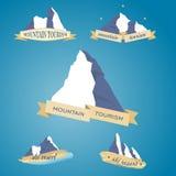 Καθορισμένο σύμβολο βουνών με την κορδέλλα Στοκ Φωτογραφία