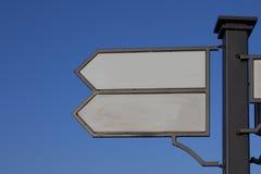 Καθοδηγήστε την πορεία δεικτών, που βρίσκεται στον πόλο Στοκ Εικόνες