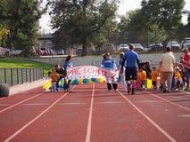 Καθολικό τρέξιμο σχολικής προσχολικό διασκέδασης Στοκ Φωτογραφία