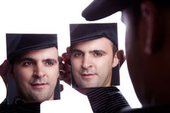 καθρέφτης ατόμων προσώπου έ Στοκ Φωτογραφίες