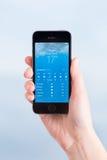 Καιρική εφαρμογή στο iPhone της Apple 5S Στοκ Εικόνες