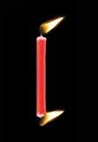 και οι δύο καίγοντας άκρες κεριών Στοκ Εικόνες