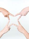 και τα τέσσερα χέρια ένα ασ&t Στοκ Φωτογραφία
