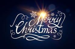 Καλλιγραφική εγγραφή Χαρούμενα Χριστούγεννας με τα κομψά χρυσά αποτελέσματα στο μπλε υπόβαθρο Εκλεκτής ποιότητας να λάμψει σχέδιο Στοκ Φωτογραφίες