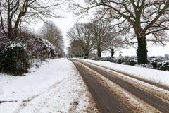 καλυμμένο οδικό χιόνι Στοκ φωτογραφία με δικαίωμα ελεύθερης χρήσης