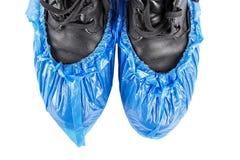 Καλύψεις παπουτσιών στα παπούτσια στοκ φωτογραφία με δικαίωμα ελεύθερης χρήσης