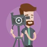 Καμεραμάν με τη κάμερα κινηματογράφων στο τρίποδο απεικόνιση αποθεμάτων
