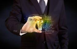 Καμμένος λάμπα φωτός γυαλιού εκμετάλλευσης επιχειρηματιών Στοκ φωτογραφία με δικαίωμα ελεύθερης χρήσης