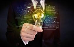 Καμμένος λάμπα φωτός γυαλιού εκμετάλλευσης επιχειρηματιών Στοκ Φωτογραφία