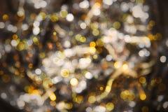 Καμμένος χρυσή σύσταση υποβάθρου, Disco, εορτασμού ή Χριστουγέννων φω'των Στοκ Εικόνες