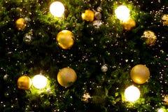 Καμμένος χρυσό υπόβαθρο Χριστουγέννων Φω'τα Χριστουγέννων στοκ εικόνες