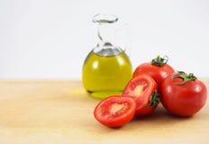 Κανάτα και ντομάτες πετρελαίου Στοκ Εικόνες