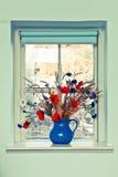 Κανάτα των λουλουδιών στοκ φωτογραφίες