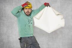 Κανένα σχέδιο κατασκευής, ο εργαζόμενος δεν αρπάζει το κεφάλι του Στοκ Εικόνα
