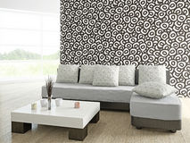 Καναπές και πίνακας κοντά στον τοίχο Στοκ φωτογραφία με δικαίωμα ελεύθερης χρήσης
