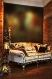 καναπές κηροπηγίων Στοκ Εικόνες