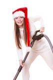 Καπέλο Άγιου Βασίλη κοριτσιών με την ηλεκτρική σκούπα Στοκ Εικόνες