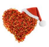 Καπέλο Santa στην καρδιά Στοκ Εικόνες