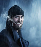 Καπετάνιος στη βροχή με το συριγμό Στοκ Εικόνες