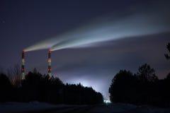 Καπνοδόχοι τη νύχτα Στοκ Φωτογραφία
