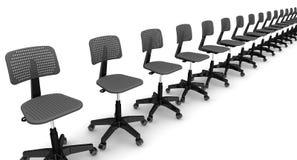 Καρέκλες γραφείων που παρατάσσονται στη σειρά Στοκ Φωτογραφία