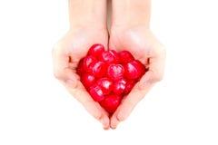 Καραμέλα αγάπης στο θηλυκό χέρι Στοκ εικόνα με δικαίωμα ελεύθερης χρήσης