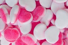 Καραμέλες ζάχαρης καρδιών ζελατίνας ρόδινο λευκό ανασκόπησης στοκ φωτογραφία