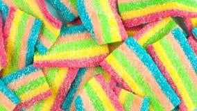 Καραμέλες με τη ζελατίνα και τη ζάχαρη ζωηρόχρωμη σειρά διαφορετικών γλυκών και απολαύσεων childs Φωτεινό υπόβαθρο κομμάτων Στοκ φωτογραφία με δικαίωμα ελεύθερης χρήσης