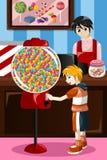 Καραμέλα αγοράς παιδιών από μια μηχανή πώλησης ελεύθερη απεικόνιση δικαιώματος