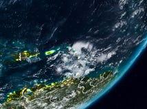 Καραϊβικές Θάλασσες στη γη τη νύχτα ελεύθερη απεικόνιση δικαιώματος