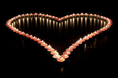 καρδιά κεριών που αποτελείται Στοκ φωτογραφίες με δικαίωμα ελεύθερης χρήσης